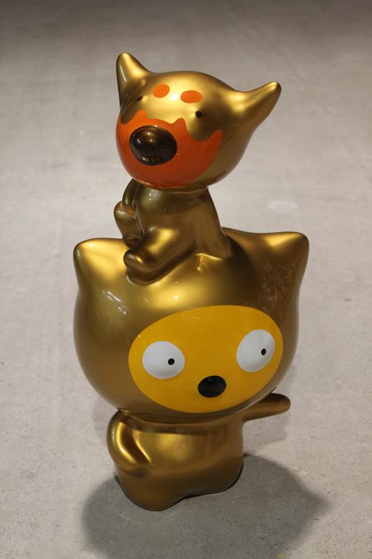 Gold Suki on a Big Head Taehee, 30x24x57cm, car paint on plastic, 2012.JPG